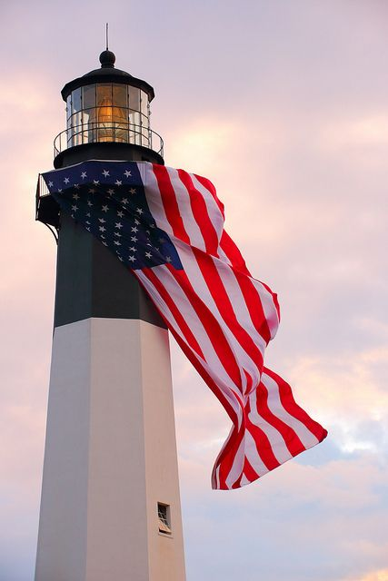 The Lighthouse with an American Flag